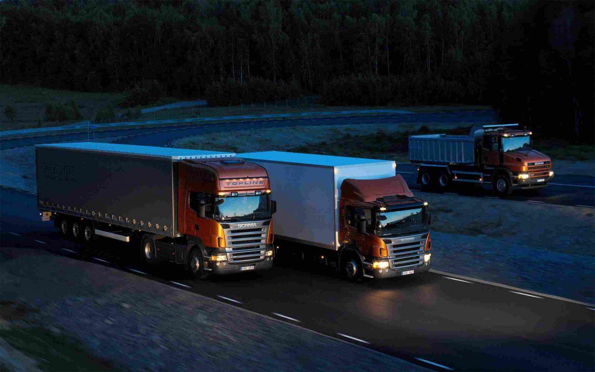 Three-orange-Scania-trucks