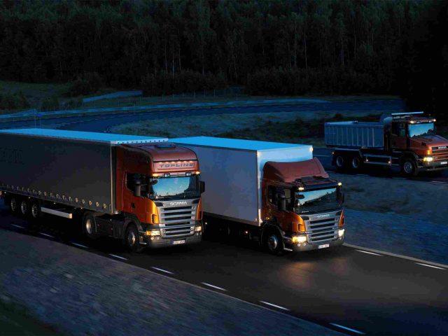 https://www.easyimportusa.com/wp-content/uploads/2015/09/Three-orange-Scania-trucks-640x480.jpg